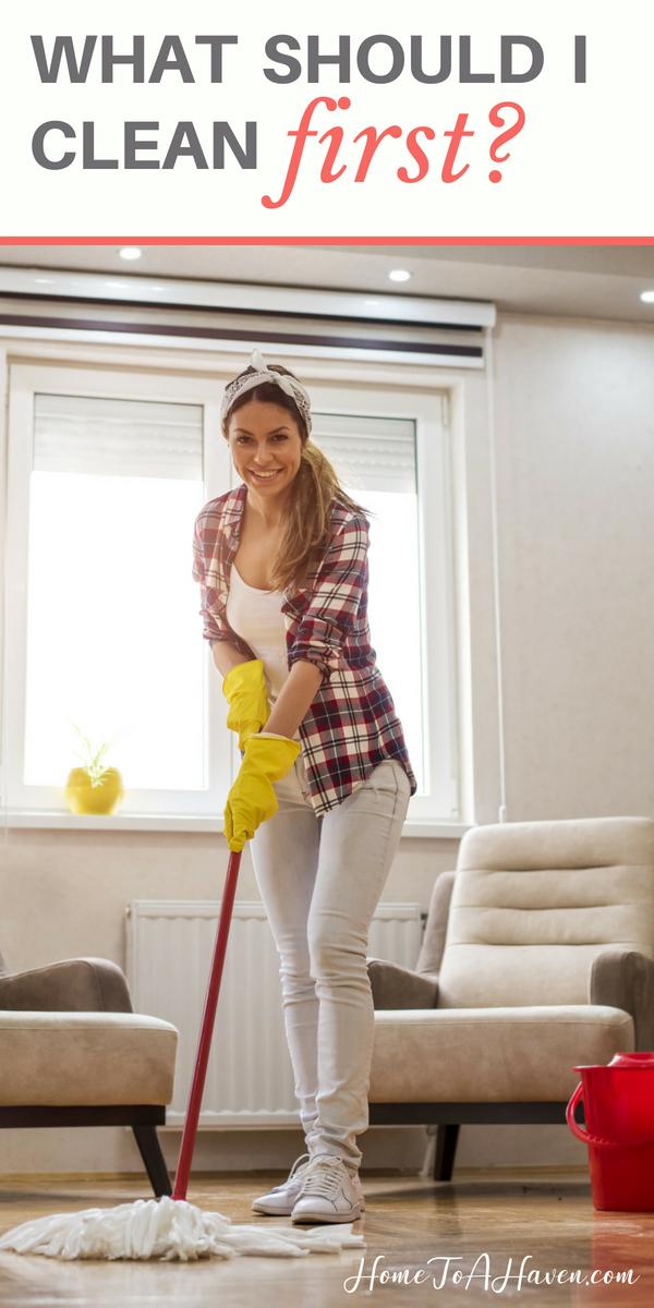 Woman mops hardwood floor