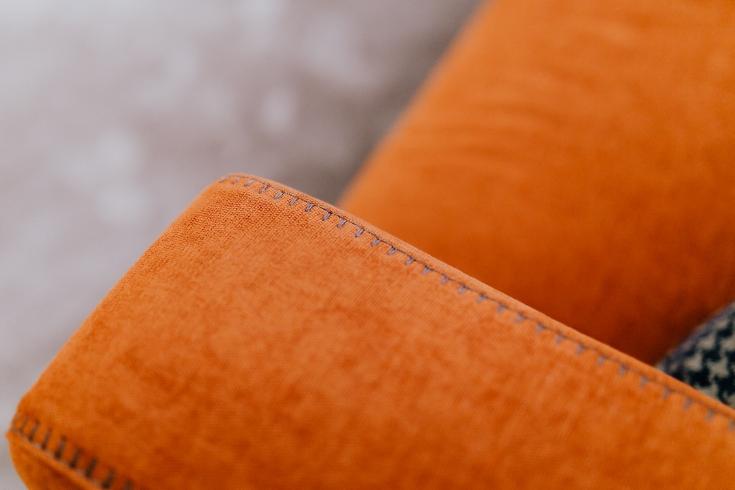 Orange sofa cushion