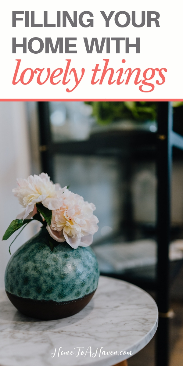 Blue vase with white flowers sits on a table