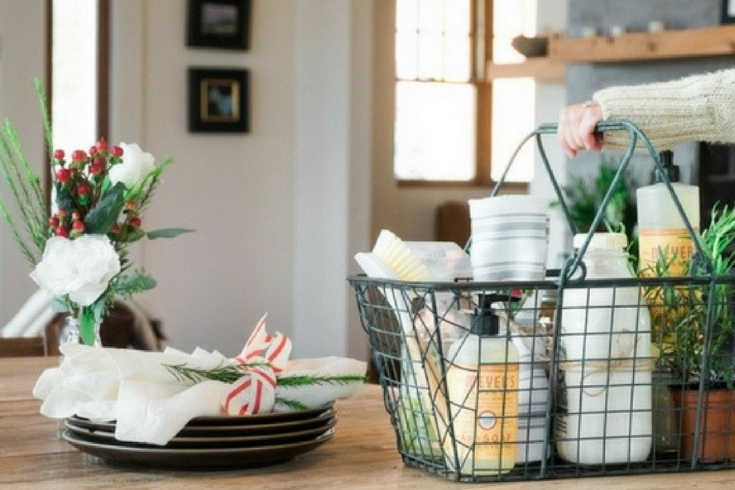 Basket filled with cleaning products sits on kitchen counter