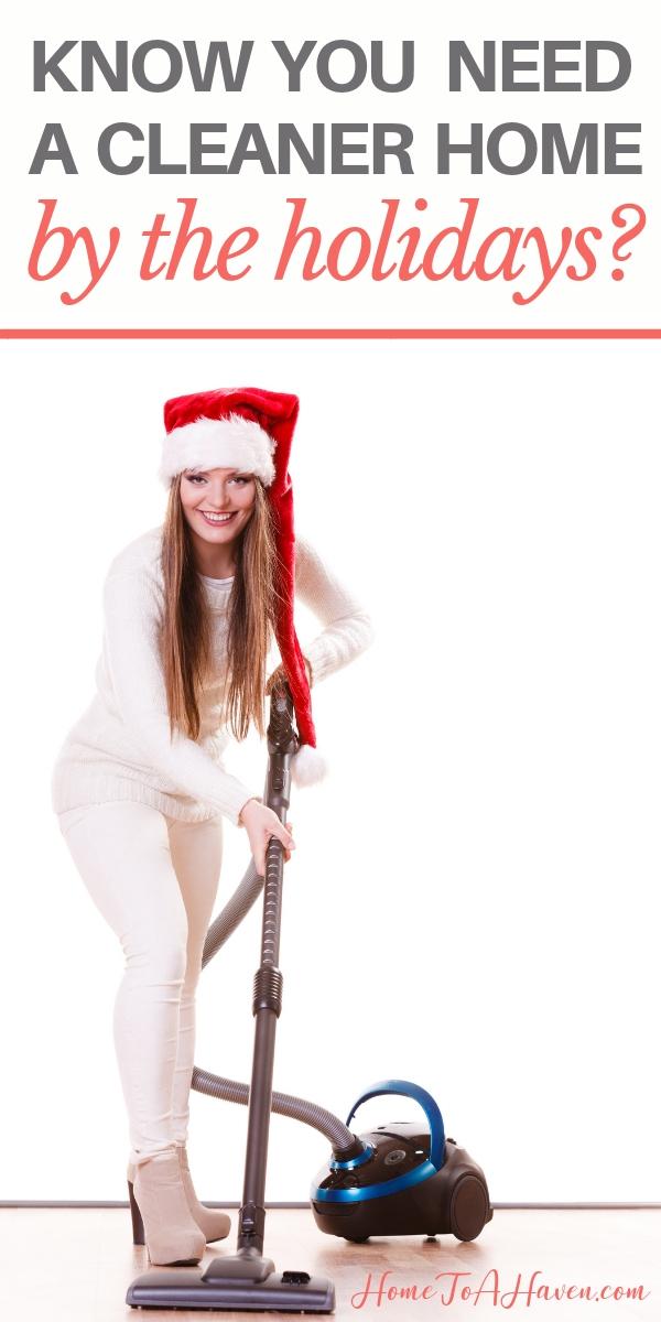 Woman in Santa hat vacuums floor