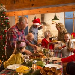 Family gathers around the Christmas dinner table