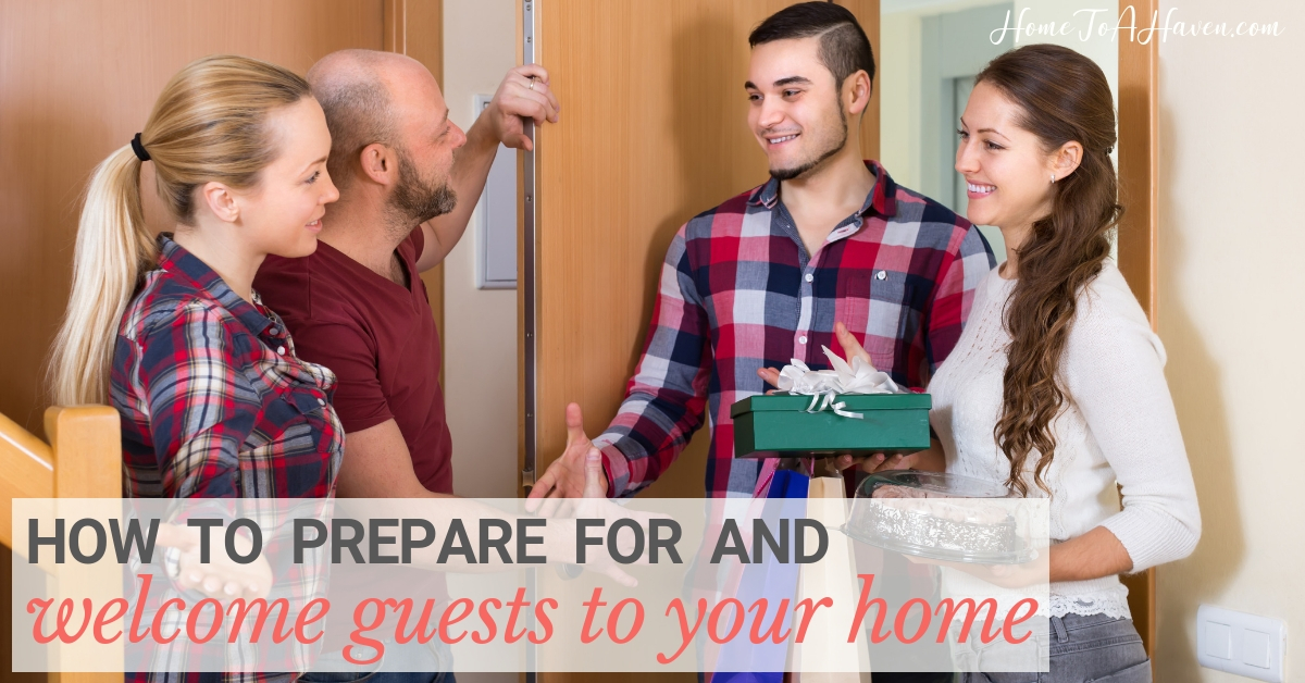 Smiling couple welcomes another couple to their home